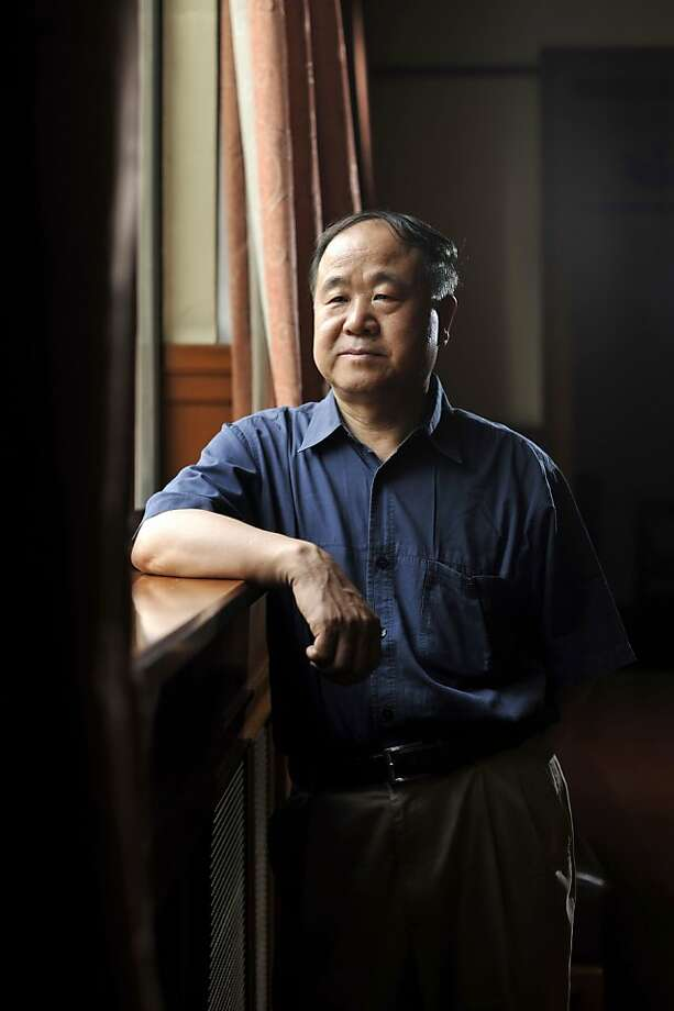 In this photo taken Tuesday Aug. 2, 2011, Chinese writer Mo Yan poses for photos in a theater in Beijing. Mo was awarded the Nobel Prize in literature on Thursday, Oct 11, 2012, a cause of pride for a government that had disowned the only previous Chinese winner of the award, an exiled critic. (AP Photo) CHINA OUT Photo: Associated Press