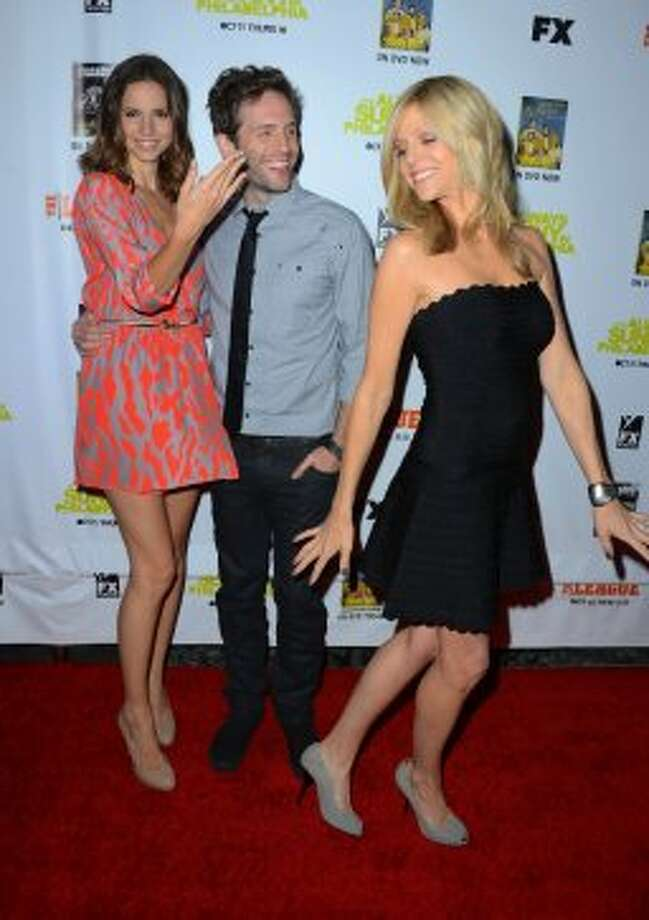 "Actors Jill Latiano, Glenn Howerton and Kaitlin Olson arrive at the Premiere Screenings of FX's ""It's Always Sunny In Philadelphia"" Season 8 And ""The League"" Season 4 -at ArcLight Cinemas Cinerama Dome on October 9, 2012 in Hollywood, California.   (Frazer Harrison / Getty Images)"