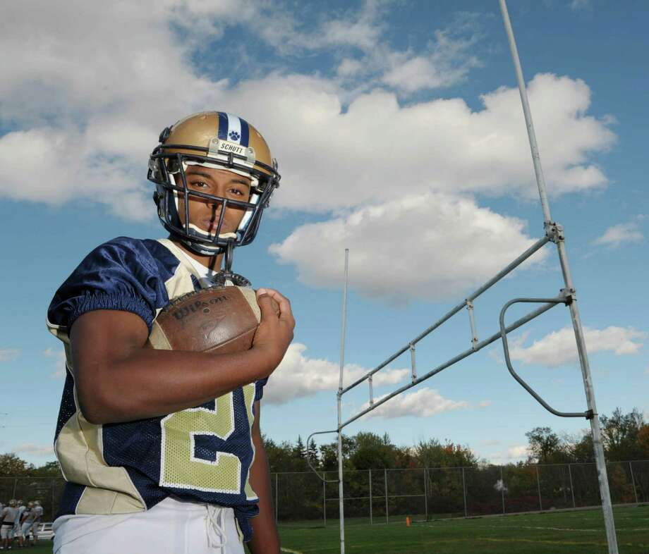 Cohoes High School football running back and band member Daishawne Sturdivant poses for a photograph at the school on Thursday, Oct. 11, 2012 in Cohoes, NY.   (Paul Buckowski / Times Union) Photo: Paul Buckowski