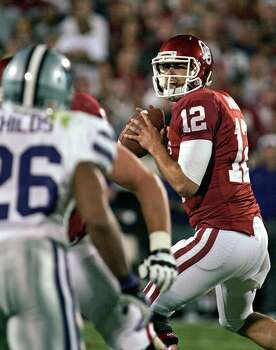 Quarterback Landry Jones #12 of the Oklahoma Sooners looks to throw against the Kansas State Wildcats  on Sept. 22, 2012, at Gaylord Family-Oklahoma Memorial Stadium in Norman, Okla. Kansas State beat Oklahoma 24-19. Photo: Brett Deering, Getty Images / 2012 Getty Images