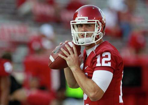Oklahoma quarterback Landry Jones throws before the start of an NCAA college football game against Kansas State in Norman, Okla., Saturday, Sept. 22, 2012. Photo: Sue Ogrocki, Associated Press / AP
