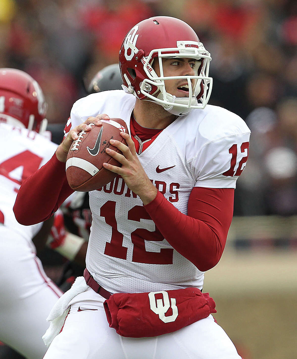 Oklahoma's Landry Jones looks to throw against Texas Tech during an NCAA college football game in Lubbock, Saturday, Oct. 6, 2012.
