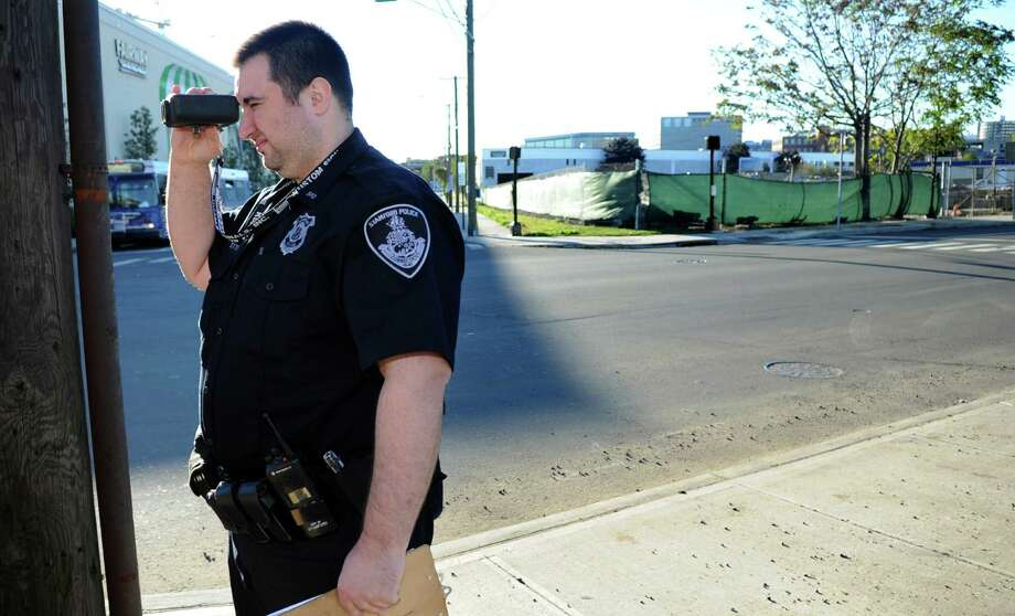 Officer Mike Franzetti checks drives' speed on Canal Street on Thursday, October 11, 2012. Officers pulled drivers over for going faster than the 25 mph speed limit on the northbound side of the road. Photo: Lindsay Niegelberg / Stamford Advocate
