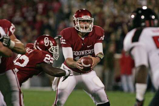 Quarterback Landry Jones #12 of the Oklahoma Sooners looks to hand off in the first half against the Texas Tech Red Raiders on Oct. 22, 2011, at Gaylord Family-Oklahoma Memorial Stadium in Norman, Okla. Photo: Brett Deering, Getty Images / 2011 Getty Images
