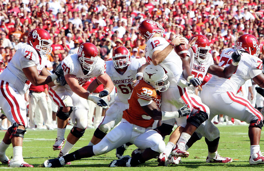 The Texas Longhorns' Eddie Jones sacks the Oklahoma Sooners' Landry Jones during second half action of the Red River Rivalry Saturday, Oct. 17, 2009, at the Cotton Bowl in Dallas. Photo: Edward A. Ornelas, San Antonio Express-News / eaornelas@express-news.net