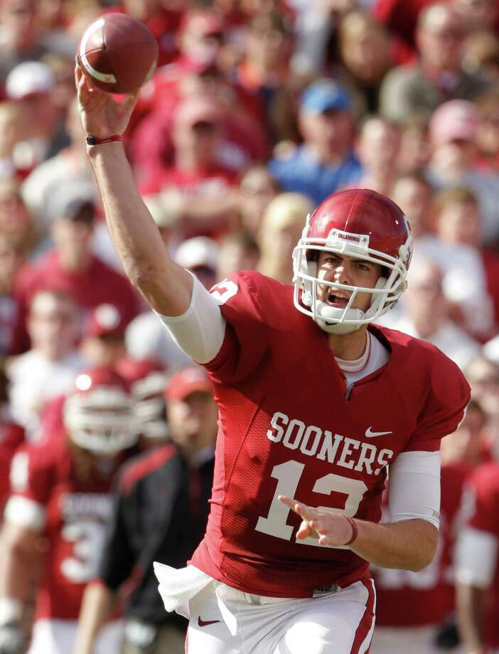 In this Nov. 28, 2009, file photo, Oklahoma quarterback Landry Jones passes against Oklahoma State in the first quarter of an NCAA college football game in Norman, Okla. Photo: Sue Ogrocki, Associated Press / AP