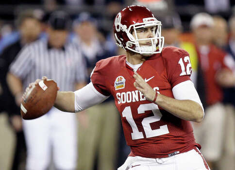 In this Jan. 2, 2011 file photo, Oklahoma quarterback Landry Jones throws a pass against Connecticut during the second quarter of the Fiesta Bowl NCAA football game in Glendale, Ariz. Photo: Paul Connors, Associated Press / UPI