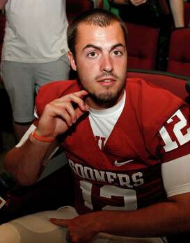 Oklahoma quarterback Landry Jones gestures as he answers a question during an interview at the NCAA college football team's media day in Norman, Okla., Saturday, Aug. 6, 2011. Photo: Sue Ogrocki, Associated Press / AP