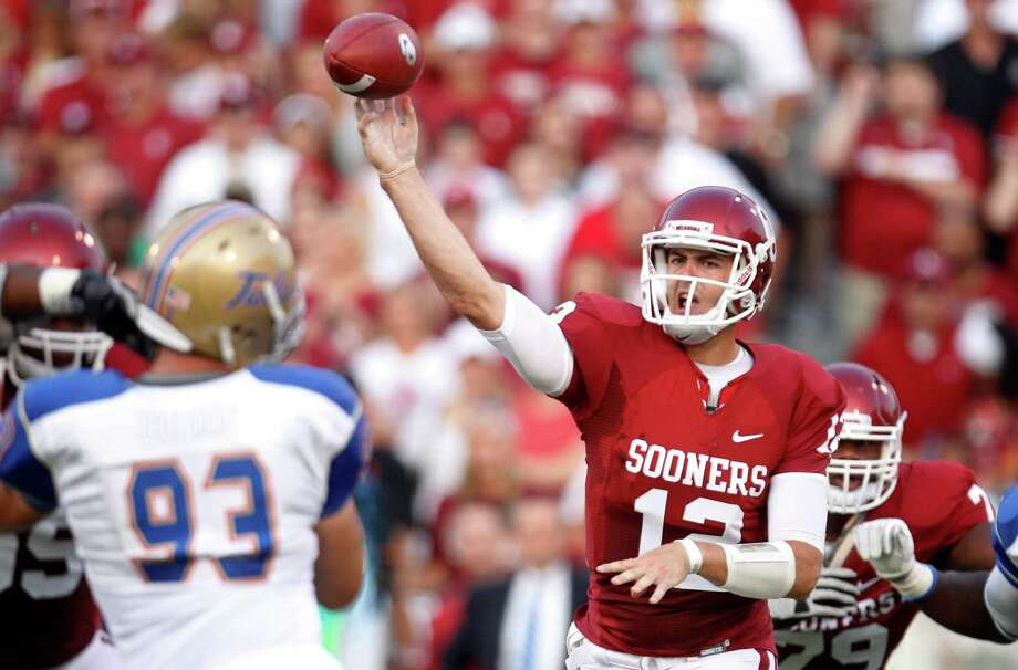 Oklahoma quarterback Landry Jones passes against Tulsa in the first quarter of an NCAA college football game in Norman, Okla., Saturday, Sept. 3, 2011. Photo: Sue Ogrocki, Associated Press / AP