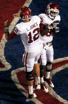 Oklahoma quarterback Landry Jones (12) celebrates a touchdown with wide receiver Ryan Broyles (85) during the second half of an NCAA college football game against Kansas in Lawrence, Kan., Saturday, Oct. 15, 2011. Oklahoma defeated Kansas 17-47. Photo: Orlin Wagner, Associated Press / AP