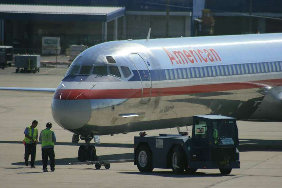 An American flight is ready to go at Salt Lake City International Airport. The airline's recent troubles began Sept. 4, when a bankruptcy court judge let it toss out the pilots' contract and set its own pay and work rules. Photo: Bill Montgomery