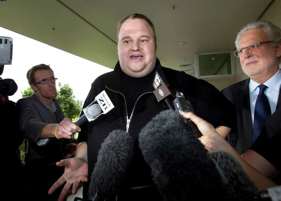 FILE - In this Feb. 22, 2012 file photo, Kim Dotcom, the founder of the file-sharing website Megaupload, comments after he was granted bail and released in Auckland, New Zealand.  In a move bound to provoke U.S. prosecutors and entertainment executives, indicted Megaupload founder Kim Dotcom is planning to offer a new online music service and a replacement of his shuttered website by year?s end. (AP Photo/New Zealand Herald, Brett Phibbs, File) NEW ZEALAND OUT, AUSTRALIA OUT Photo: Brett Phibbs / New Zealand Herald