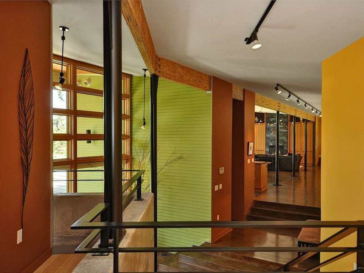 Interior of 231 Indigo Lane, in Roslyn. The 3,412-square-foot house, built in 2007, has two bedrooms, 2.25 bathrooms, heated concrete floors, high ceilings, an open floor plan, a family room, walls of glass, patios and a three-car garage on a 3-acre lot with views of the Cascade mountains. It's listed for $1.495 million.