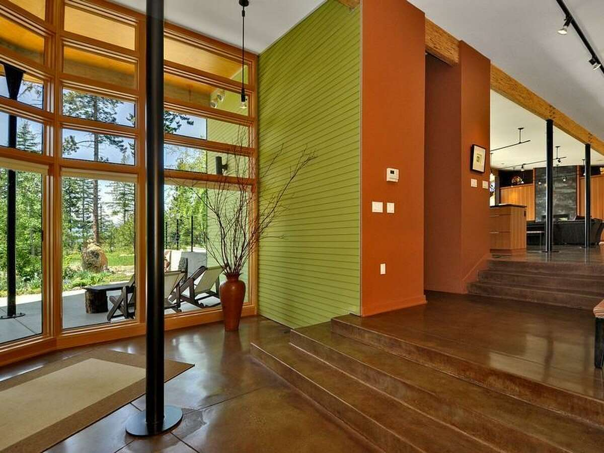 Entry of 231 Indigo Lane, in Roslyn. The 3,412-square-foot house, built in 2007, has two bedrooms, 2.25 bathrooms, heated concrete floors, high ceilings, an open floor plan, a family room, walls of glass, patios and a three-car garage on a 3-acre lot with views of the Cascade mountains. It's listed for $1.495 million.