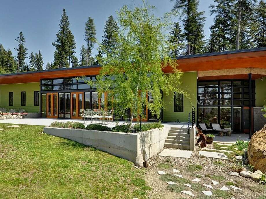 Want to get away from the city, but not contemporary style? Check out this home for sale, 231 Indigo Lane, in Roslyn. Architect Rick Mohler designed the 3,412-square-foot house, built in 2007. It has two bedrooms, 2.25 bathrooms, heated concrete floors, high ceilings, an open floor plan, a family room, walls of glass, patios and a three-car garage on a 3-acre lot with views of the Cascade mountains. It's listed for $1.495 million. Photo: Courtesy Chris Doucet/Realogics Sotheby's International Realty