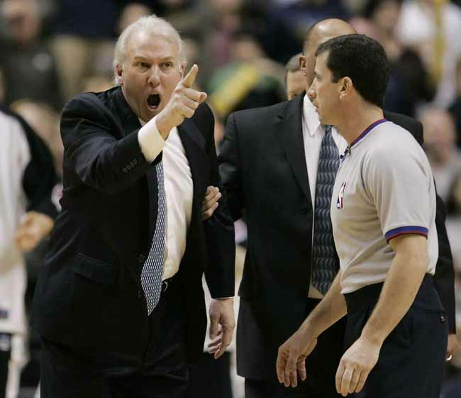 San Antonio Spurs coach Gregg Popovich, left, argues a call with official Tim Donaghy during the fourth quarte of an NBA basketball game against the Indiana Pacers in Indianapolis, Sunday, Feb. 12, 2006. San Antonio defeated Indiana 92-88. (AP Photo/Darron Cummings) Photo: DARRON CUMMINGS, ASSOCIATED PRESS / AP2006