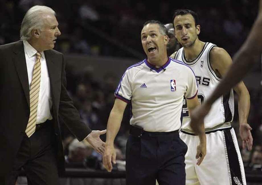 SPORTS - Greg Popovich and Manu Ginobili question a cal by ref Jason Phillips in the first half Wednesday, November 7, 2007 at the AT&T Center. BAHRAM MARK SOBHANI/STAFF Photo: BAHRAM MARK SOBHANI, SAN ANTONIO EXPRESS NEWS / SAN ANTONIO EXPRESS NEWS