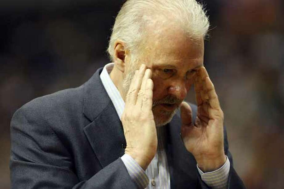 FOR SPORTS - Spurs' headcoach Gregg Popovich walks along the bench during first half action of Game 4 in the First Round of the Western Conference Playoffs against the Mavericks Saturday April 25, 2009 at the American Airlines Center in Dallas, Tx. (PHOTO BY EDWARD A. ORNELAS/eaornelas@express-news.net) Photo: EDWARD A. ORNELAS, SAN ANTONIO EXPRESS-NEWS / eaornelas@express-news.net