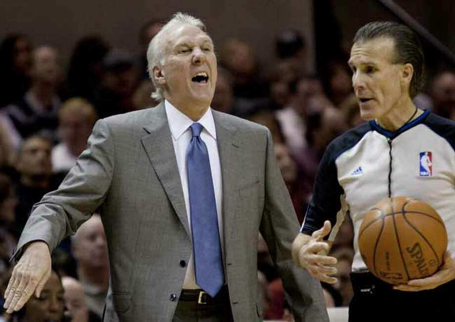 San Antonio Spurs' head coach Gregg Popovich yells to his team during the first half of an NBA basketball game against the New Orleans Hornets, Sunday, Dec. 5, 2010. Photo: Darren Abate, Darren Abate/Special To The Expr