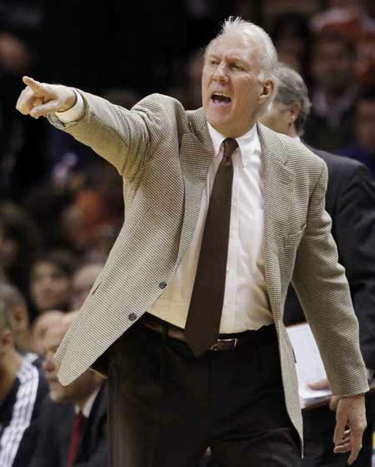 San Antonio Spurs head coach Gregg Popovich yells during the second half of an NBA basketball game against the Washington Wizards, Sunday, Dec. 26, 2010, in San Antonio. San Antonio won 94-80. Photo: Darren Abate, Darren Abate/Special To The Expr / Copyright: Darren Abate/pressphotointl.com