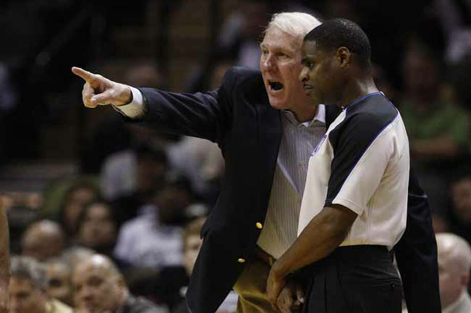 SPURS -- San Antonio Spurs Head Coach Gregg Popovich argues a call with Leroy Richardson in the second half against the Toronto Raptors at the AT&T Center, Wednesday, Jan. 19, 2011. The Spur won 104-95 and improve to 36-6. JERRY LARA/glara@express-news.net Photo: JERRY LARA, San Antonio Express-News / glara@express-news.net