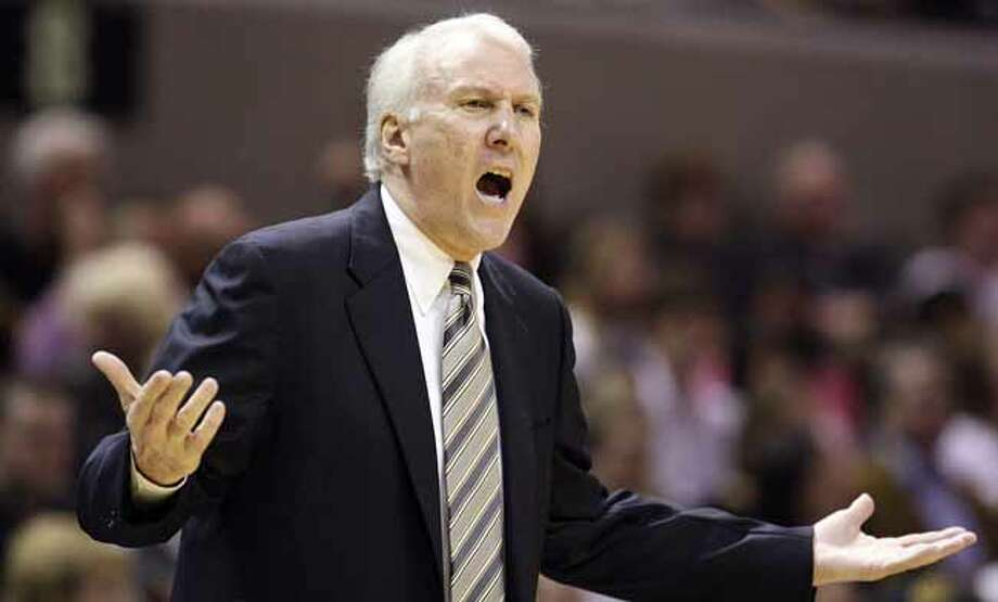 FOR SPORTS - Spurs' head coach Gregg Popovich reacts after a play against the  Bobcats during first half action Saturday March 19, 2011 at the AT&T Center.  (PHOTO BY EDWARD A. ORNELAS/eaornelas@express-news.net) Photo: EDWARD A. ORNELAS, SAN ANTONIO EXPRESS-NEWS / SAN ANTONIO EXPRESS-NEWS NFS