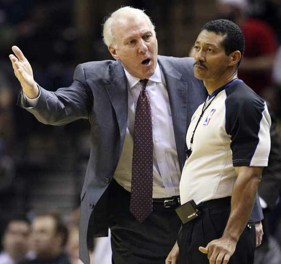 FOR SPORTS - Spurs' head coach Gregg Popovich looks for a call from official Bill Kennedy  during second half action against the Warriors Monday March 21, 2011 at the AT&T Center. The Spurs won 111-96.  (PHOTO BY EDWARD A. ORNELAS/eaornelas@express-news.net) Photo: EDWARD A. ORNELAS, SAN ANTONIO EXPRESS-NEWS / SAN ANTONIO EXPRESS-NEWS NFS