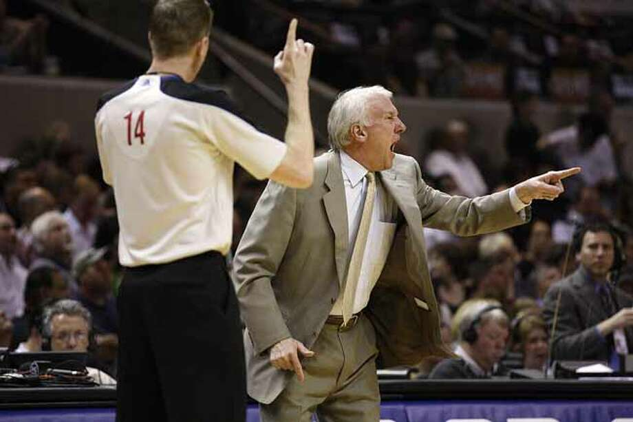 SPURS -- San Antonio Spurs Head Coach Gregg Popovich reacts to a call in their game against the Memphis Grizzlies in the NBA Western Conference First Round at the AT&T Center, Sunday, April 17, 2011. Next Popovich is official Ed Malloy.  JERRY LARA/glara@express-news.net Photo: JERRY LARA, San Antonio Express-News / SAN ANTONIO EXPRESS-NEWS (NFS)