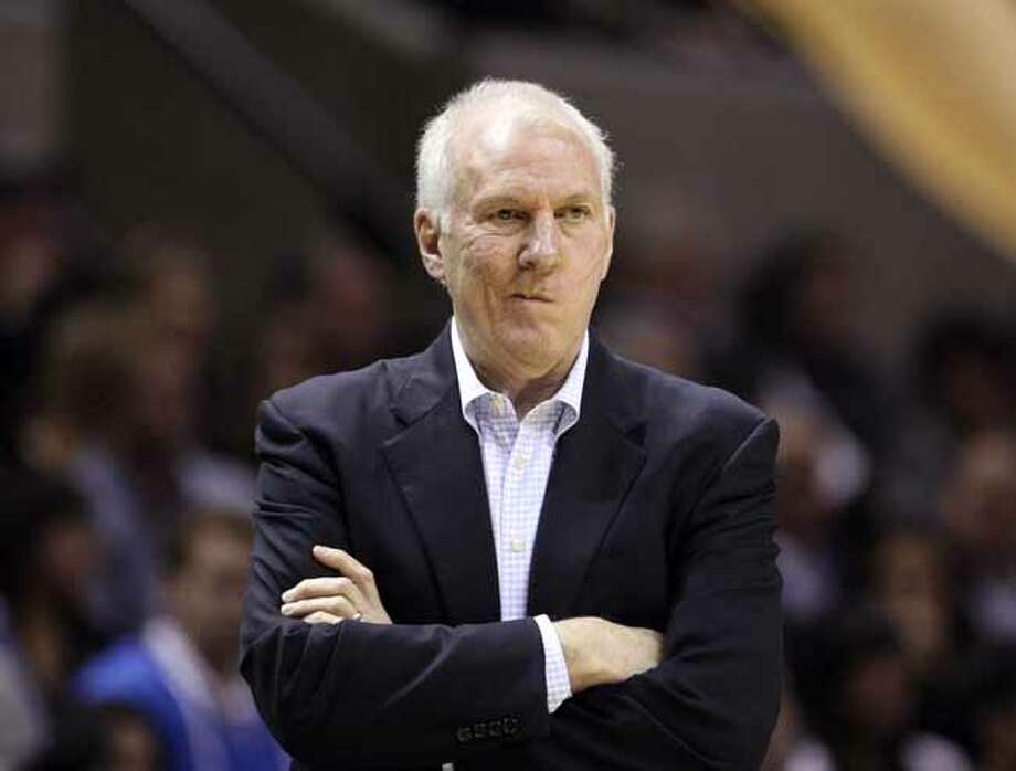FOR SPORTS - San Antonio Spurs head coach Gregg Popovich looks on during first half action Thursday Jan. 5, 2012 at the AT&T Center.  (PHOTO BY EDWARD A. ORNELAS/eaornelas@express-news.net) Photo: EDWARD A. ORNELAS, SAN ANTONIO EXPRESS-NEWS / SAN ANTONIO EXPRESS-NEWS (NFS)