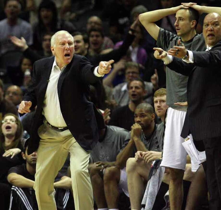 Spurs head coach Gregg Popovich yells at a referee after a call in the second half Spurs vs Nuggets, Sunday, March 4, 2012. The Nuggets beat the Spurs 99-94. (JENNIFER WHITNEY) Photo: JENNIFER WHITNEY, Special To The Express-News / special to the Express-News