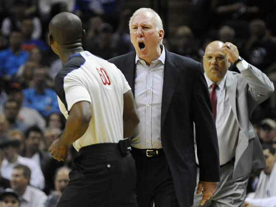 San Antonio Spurs head coach Gregg Popovich, center, yells at referee James Williams, left, before being ejected in the second half of an NBA basketball game against the New York Knicks, Wednesday, March 7, 2012, in San Antonio. San Antonio won 118-105. Photo: AP