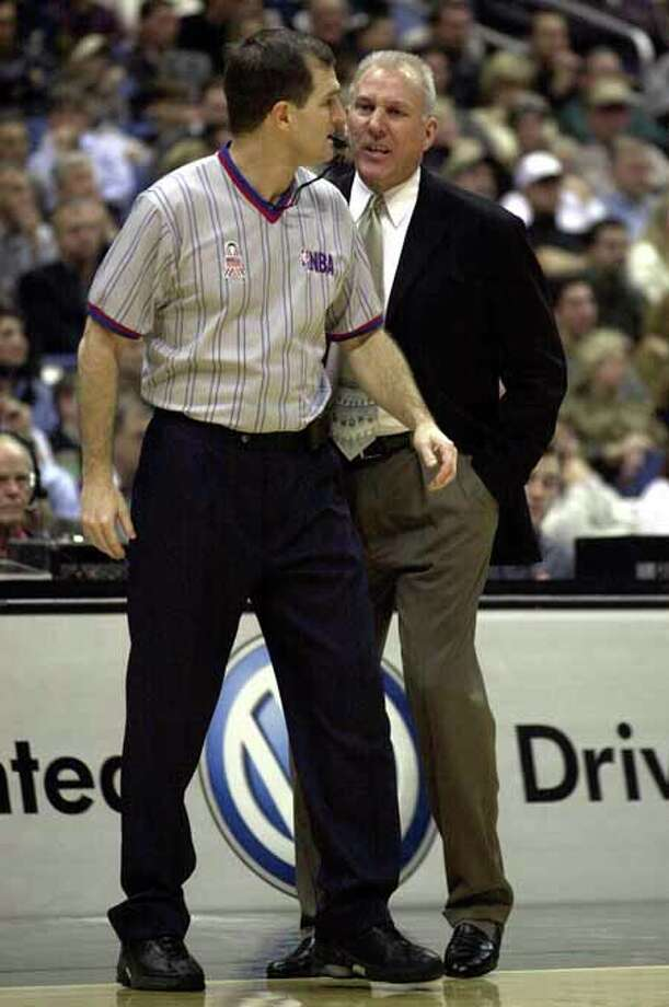 SPORTS - Spurs coach Gregg Popovich (right) screams at NBA referee Gary Benson and as a result gets tossed from the game against the Indiana Pacers on Friday, January 4, 2002. Kin Man Hui/staff. Photo: KIN MAN HUI, SAN ANTONIO EXPRESS-NEWS / SAN ANTONIO EXPRESS-NEWS