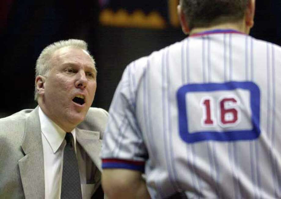 The San Antonio Spurs' head coach Gregg Popovich confers with game official #16, Ted Bernhardt, who fans accused of missing calls against the Nets throughout the second half Tuesday, Jan. 22, 2002 at the Alamodome in San Antonio.  (KAREN L. SHAW/STAFF) Photo: KAREN L. SHAW, SAN ANTONIO EXPRESS-NEWS / SAN ANTONIO EXPRESS-NEWS