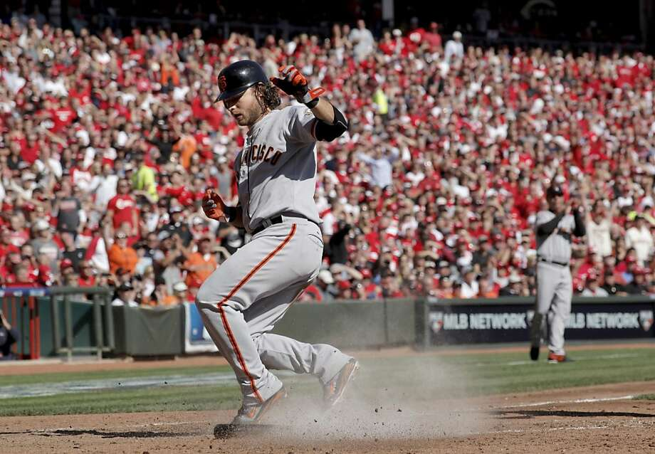 After driving in the Giants' first run, Brandon Crawford scores the second on Zack Cozart's error in the fifth inning. Photo: Michael Macor, The Chronicle
