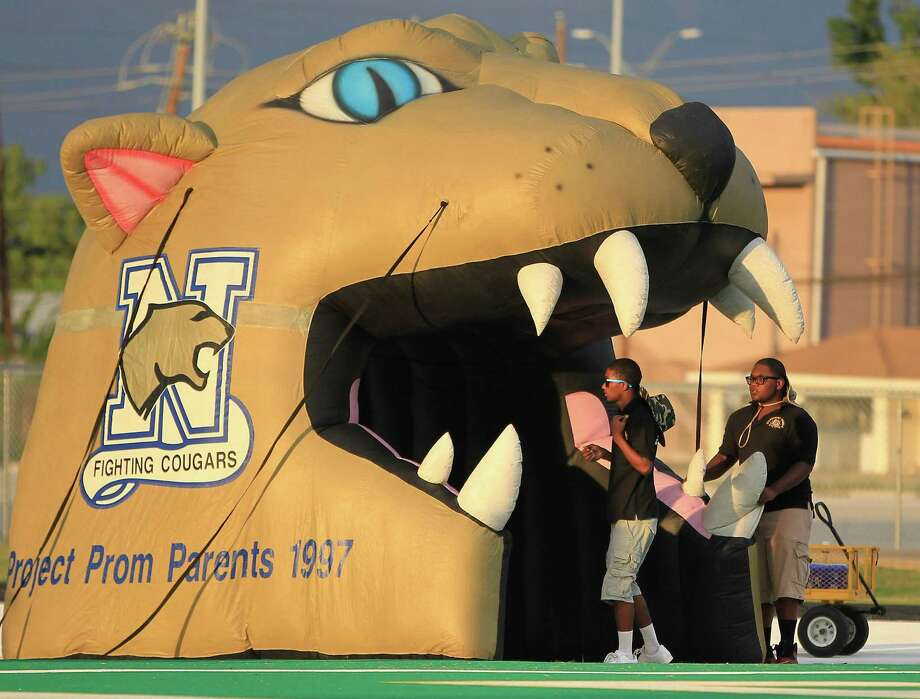 Nimitz students prepare an inflatable cougar before the start of the Nimitz High school football game played against Alief Taylor at Crump Stadium, Thursday, Oct. 11, 2012, in Houston. Photo: Karen Warren, Houston Chronicle / © 2012  Houston Chronicle