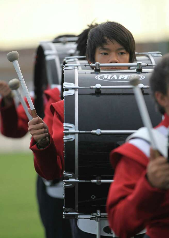 An Alief Taylor drummer walks into the stadium before the start of the Nimitz High school football game played against Alief Taylor at Crump Stadium, Thursday, Oct. 11, 2012, in Houston. Photo: Karen Warren, Houston Chronicle / © 2012  Houston Chronicle