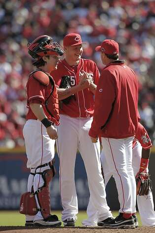 Mat Latos smiles during a mound visit, but his mood changed when Buster Posey hit a grand slam. Photo: Michael Macor, The Chronicle