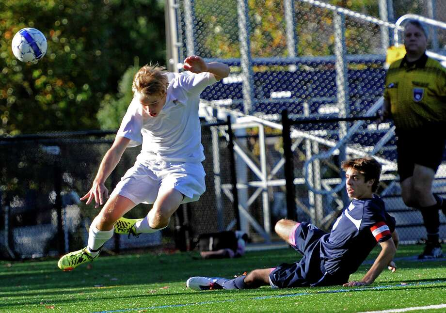 St. Luke's Jay Van Elslander and King school's Andy Farber collide going for the ball in a boys soccer game held at King school, Stamford, CT on Thursday October 11th, 2012. Photo: Mark Conrad / Stamford Advocate Freelance