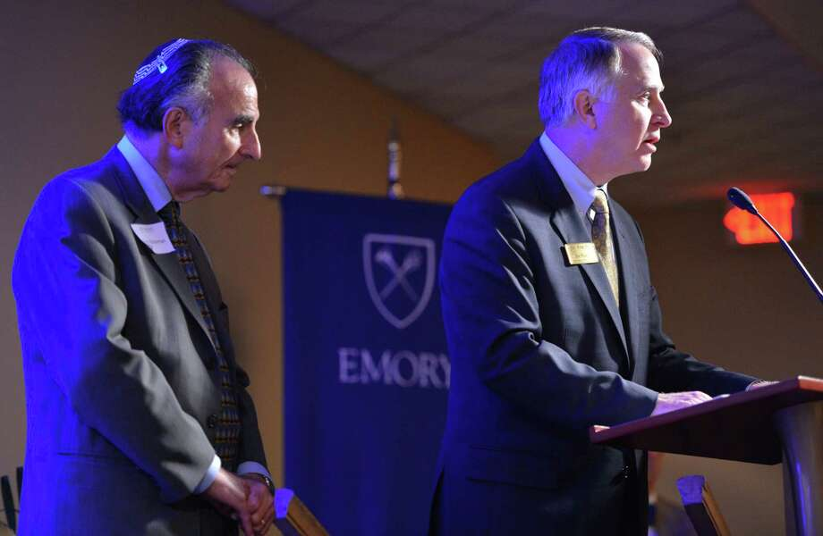 "James W. Wagner, right, president of Emory University, speaks as Perry Brickman stands after a film premiere documenting the period 1948-1961, when an abnormally high rate of failure for Jewish dental students at Emory pointed to a culture of anti-Semitism in one corner of the campus, at Emory University on Wednesday, Oct. 10, 2012. Emory University is apologizing for years of anti-Semitism at its dental school, when dozens of Jewish students were flunked out or forced to repeat courses. The documentary film ""From Silence to Recognition: Confronting Discrimination in Emory's Dental School History,""  by former dental student Perry Brickman, who was kicked out in 1952, featured interviews with dozens of men who had been affected by the school's anti-Semitism. (AP Photo/Atlanta Journal-Constitution, Hyosub Shin)  MARIETTA DAILY OUT; GWINNETT DAILY POST OUT; LOCAL TV OUT; WXIA-TV OUT; WGCL-TV OUT Photo: Hyosub Shin / AJC"