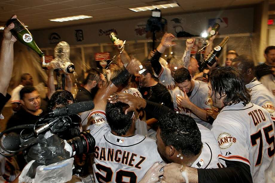 Giants players shower their teammates with Champagne to celebrate their victory over the Cincinnati Reds that sends them to the League Championship Series. Photo: Michael Macor, The Chronicle