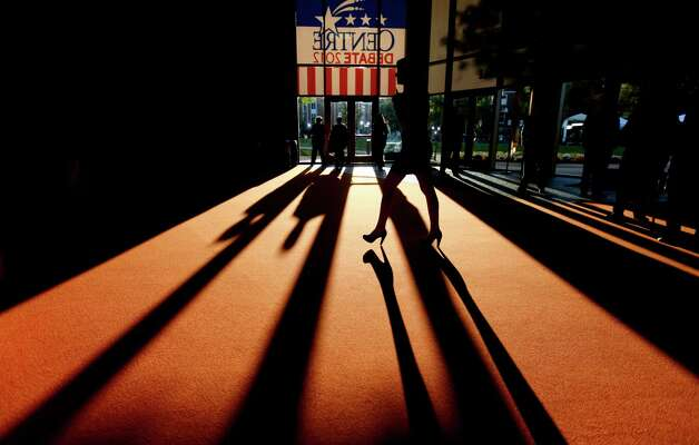 Shadows are cast across the floor as people pass by outside the debate hall ahead of the vice presidential debate with Republican vice presidential candidate, Rep. Paul Ryan, R-Wis., and Vice President Joe Biden, Thursday, Oct. 11, 2012, at Centre College in Danville, Ky. (AP Photo/David Goldman) Photo: David Goldman, STF / AP