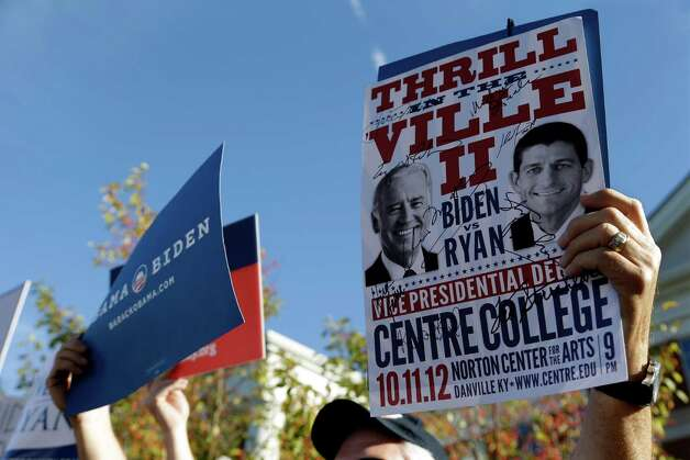 A sign promoting the Vice Presidential debate is held up at a rally on the Centre College campus, site of the debate, Thursday, Oct. 11, 2012, in Danville, Ky. Vice President Joe Biden will face Republican vice presidential candidate, Rep. Paul Ryan, R-Wis. (AP Photo/Eric Gay) Photo: Eric Gay, STF / AP