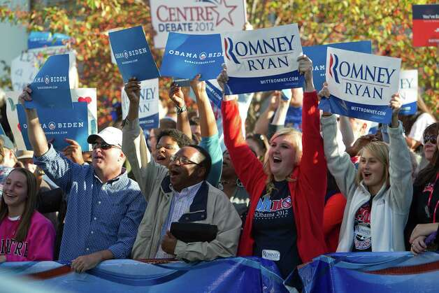 Enthusiastic supporters of both President Obama and Mitt Romney give spirited cheers outside the Vice Presidential Debate at Centre College in Danville, Kentucky. (Jonathan Palmer/Lexington Herald-Leader/MCT) Photo: Jonathan Palmer, MBR / Lexington Herald-Leader