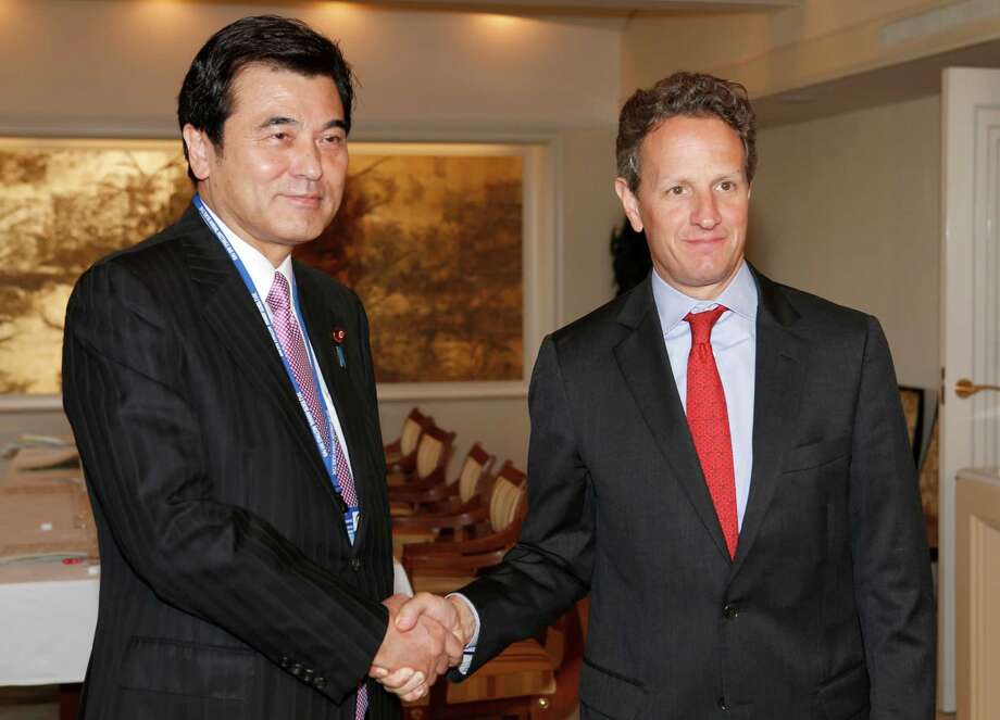 U.S. Treasury Secretary Timothy Geithner, right, and Japanese Finance Minister Koriki Jojima pose for photographers prior to their talks held on the sideline of the annual IMF/World Bank meetings in Tokyo Thursday, Oct. 11, 2012. Speaking at a financial conference Geithner said that financial reforms and other actions in response to the global crisis are yielding results, helping the U.S. economy to grow at a pace better than there was reason to expect. (AP Photo/Shizuo Kambayashi, Pool) Photo: Shizuo Kambayashi