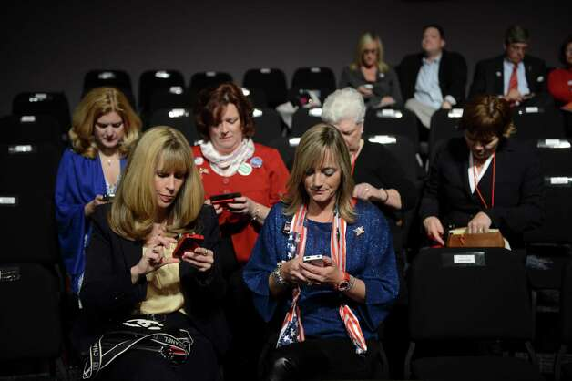 Audience members use their phones prior to the start of the vice presidential debate at Centre College in Danville, Ky., Oct. 11, 2012. The debate between Vice President Joe Biden and Rep. Paul Ryan (R-Wis.), the Republican vice presidential candidate, will be split into nine, 10-minute segments, with Martha Raddatz, the moderator, choosing the topics for each. (James Hill/The New York Times) -- NO SALES -- Photo: JAMES HILL, STR / NYTNS