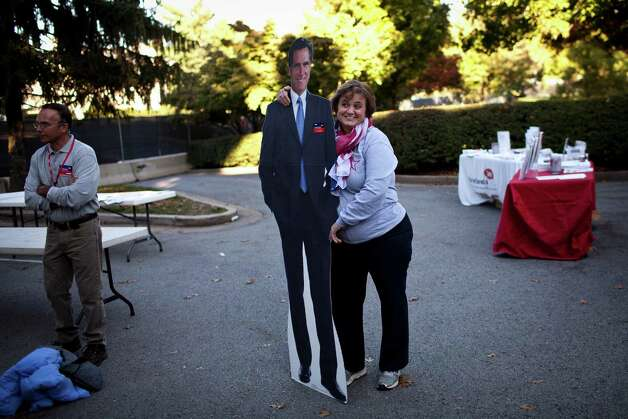 A supporter of Republican presidential candidate Mitt Romney poses with a cut out of Romney for a photo, prior to the vice presidential debate at Centre College in Danville, Ky., Oct. 11, 2012. The debate between Vice President Joe Biden and Rep. Paul Ryan (R-Wis.), the Republican vice presidential candidate, will be split into nine, 10-minute segments, with Martha Raddatz, the moderator, choosing the topics for each. (Max Whittaker/The New York Times) Photo: MAX WHTTAKER, STR / NYTNS
