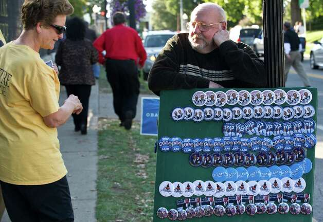 A woman looks at pins supporting US President Barack Obama and Vice President Joe Biden before the vice presidential debate at Centre College in Danville, Kentucky, on October 11, 2012.    AFP PHOTO/Nicholas KAMMNICHOLAS KAMM/AFP/GettyImages Photo: NICHOLAS KAMM, Staff / AFP