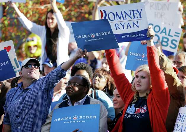 Supporters wave signs during a rally outside the Norton Center on the campus of Centre College before the vice presidential debate, Thursday, Oct. 11, 2012, in Danville, Kentucky. Vice President Joe Biden will face Republican vice presidential candidate, Rep. Paul Ryan, R-Wis., in Thursday's debate. (AP Photo/Charlie Neibergall) Photo: Charlie Neibergall, STF / AP