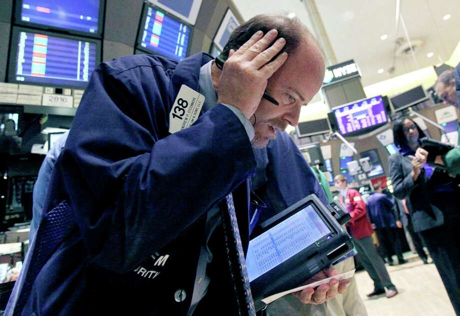 FILE - In this Oct. 9, 2012, file photo, trader Andrew O'Connor works on the floor of the New York Stock Exchange. After three straight days of losses for major stock indexes, investors appeared to be looking for bargains Thursday. (AP Photo/Richard Drew, File) Photo: Richard Drew