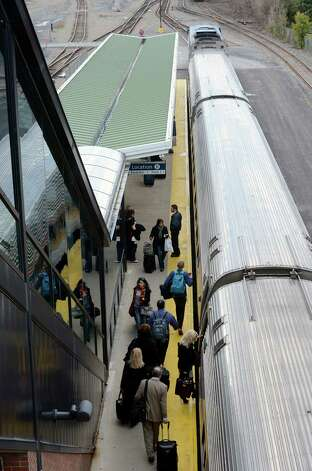 Amtrak travelers board the train for their trip to New York City at the Amtrak Station in Rensselaer, N.Y. Oct. 11, 2012.     (Skip Dickstein/Times Union) Photo: Skip Dickstein / 00019632A